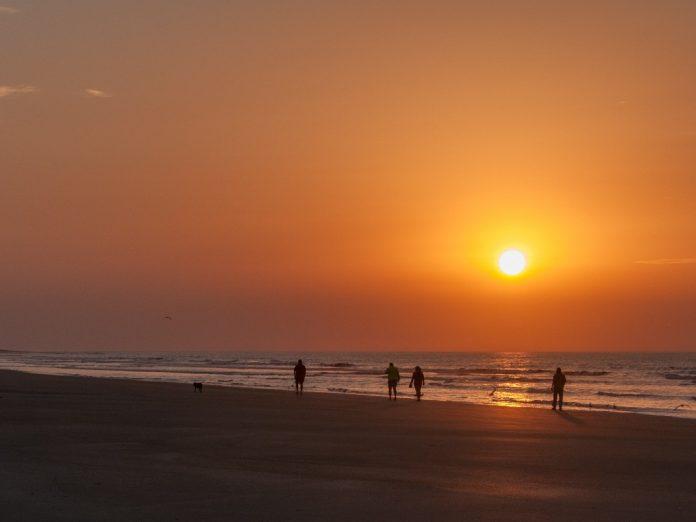 People walking on beach at Isle of Palms, South Carolina.