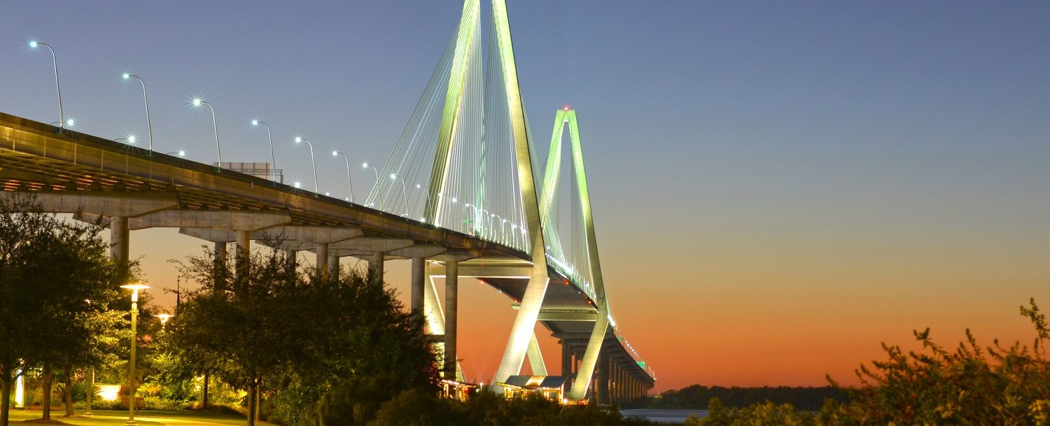 sunset over the ravenel bridge from the park