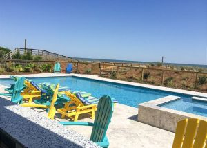 pool overlooking the beach and ocean at an East Islands Vacation Rentals home