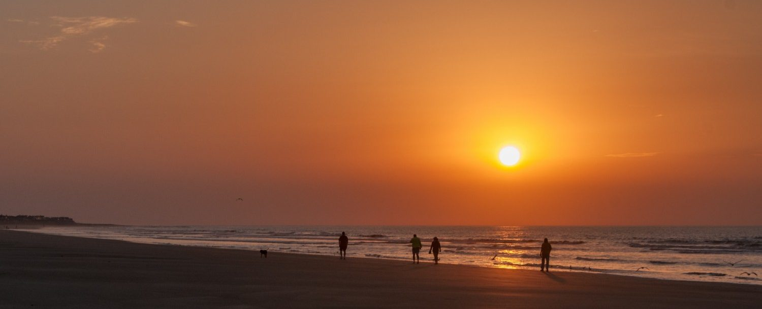People walking on beach at Isle of Palms, South Carolina.
