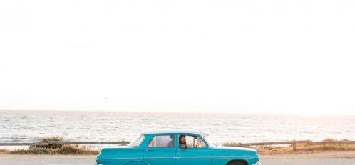 Vintage car driving along the coast
