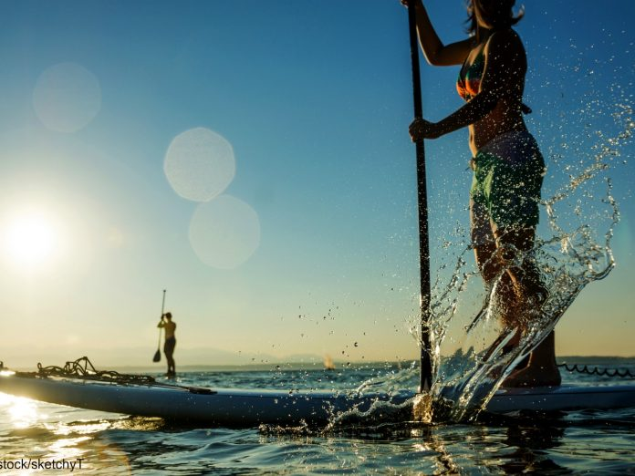paddle boarding on the ocean