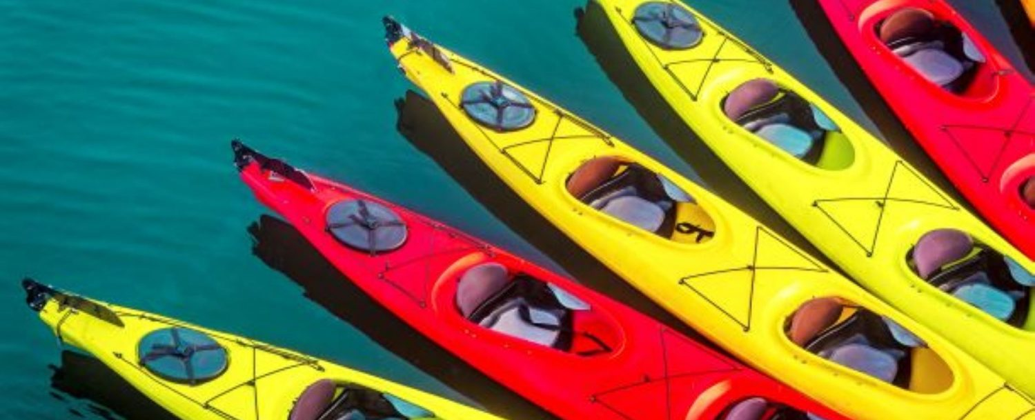 a collection of kayaks on the ocean