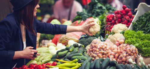 a lady at a farmers market