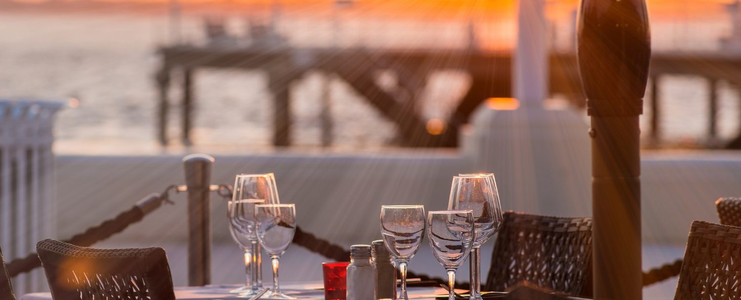 Waterfront dining at sunset