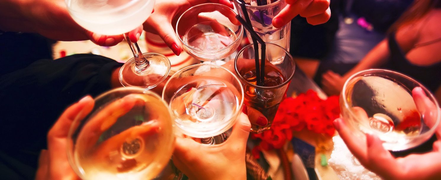 Clinking glasses with alcohol and toasting, party