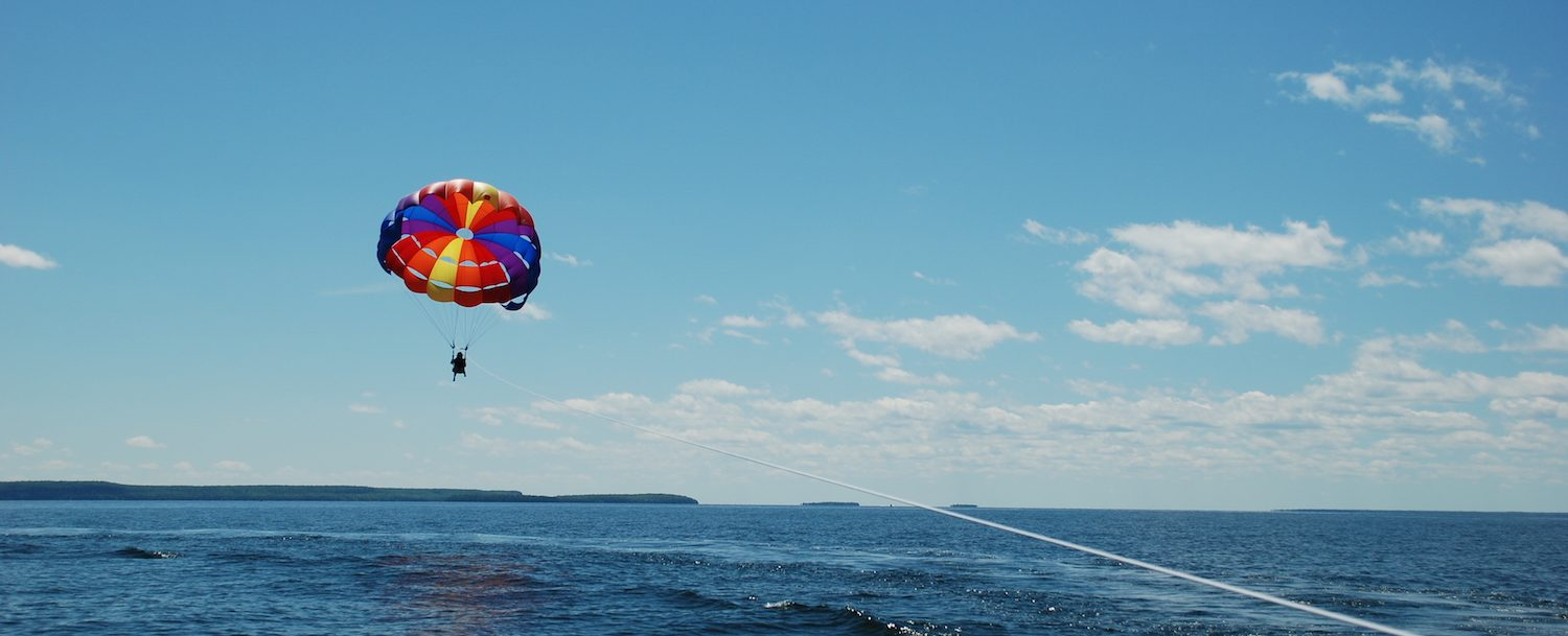 Person parasailing above the ocean.